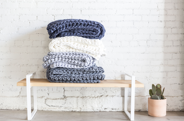 stack of blankets on bench