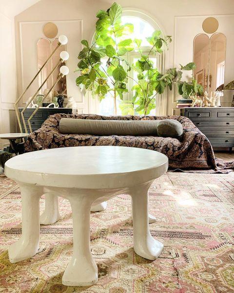 Furniture, Coffee table, Room, Table, Green, Interior design, Property, Tree, Living room, Floor,