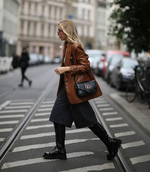berlin, germany   september 09 sonia lyson wearing givenchy shades, zara complete look, louis vuitton bag and jeffrey campbell boots on september 09, 2020 in berlin, germany photo by jeremy moellergetty images