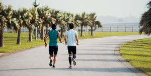 Blind triathlete running and training with his guide
