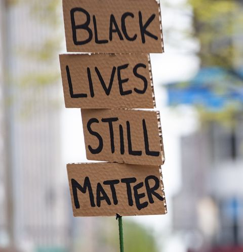 columbus, oh   april 17 a black lives matter activist holds a cardboard sign during a protest against police brutality in front of the ohio statehouse on april 17, 2021 in columbus, ohio demonstrators gathered in response to multiple recent officer involved shootings in the us including miles jackson, 27, who was fatally shot by columbus police in mount carmel st anns hospital in westerville, ohio on april 12 photo by stephen zennergetty images