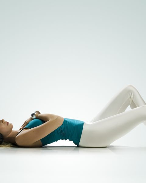 blond girl with headphones lying on ground