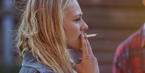 Blonde woman smoking cigarette