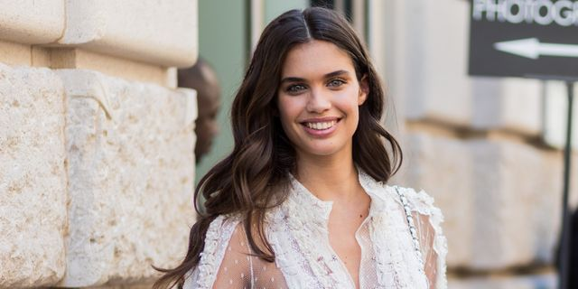 paris, france   july 05 model sara sampaio wearing a white sheer ruffled dress, white chanel bag outside elie saab during paris fashion week   haute couture fallwinter 2017 2018  day four on july 5, 2017 in paris, france photo by christian vieriggetty images