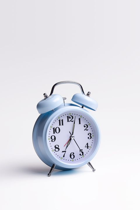 Blue alarm clock on white background