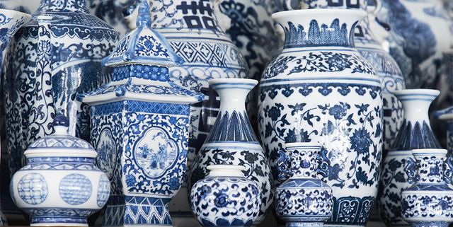 a collection of blue and white vases bottles and jars