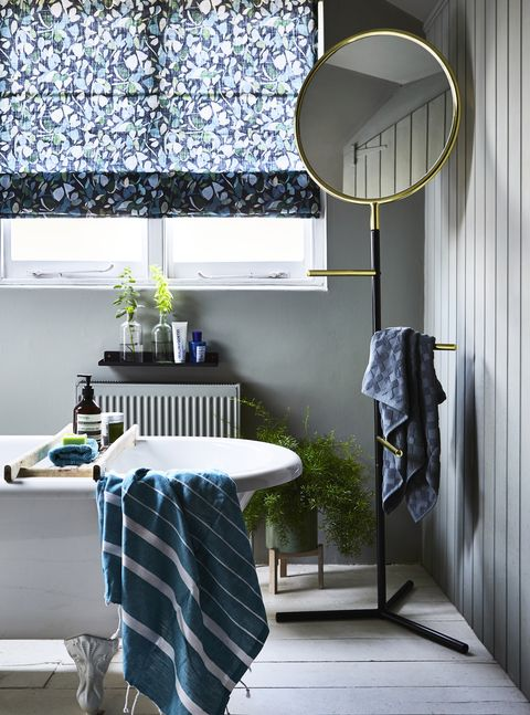 blue themed bathroom with light grey walls