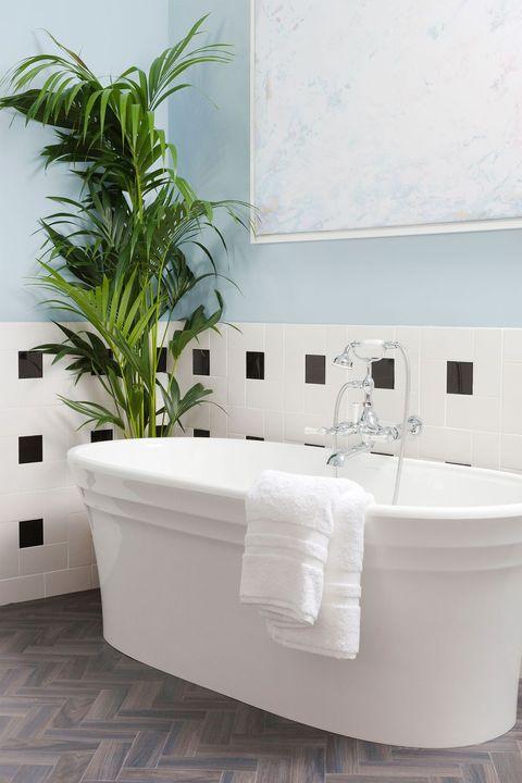 White, Bathtub, Bathroom, Property, Room, Wall, Tile, Interior design, Plumbing fixture, Flowerpot,