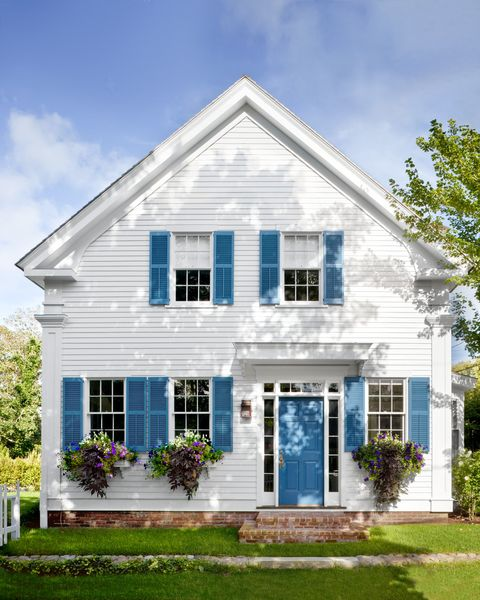 white house with blue shutters and door