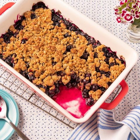 blueberry crumble with flowers on side