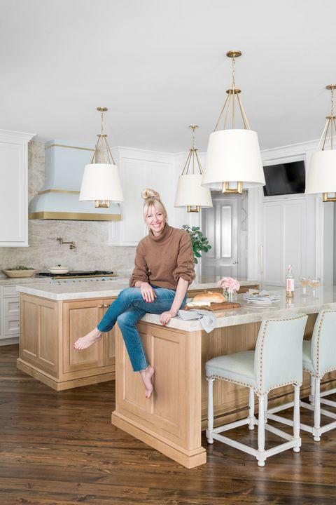 woman sitting on kitchen island