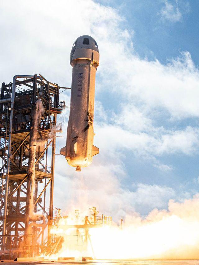 blue origin's new shepard rocket lifts off
