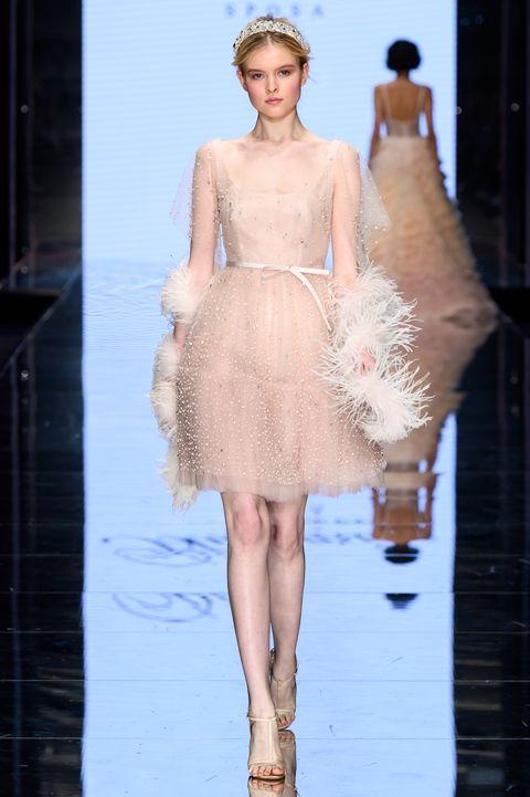 Fashion model, Fashion, Haute couture, Clothing, Fashion show, Dress, Shoulder, Runway, Cocktail dress, Neck,