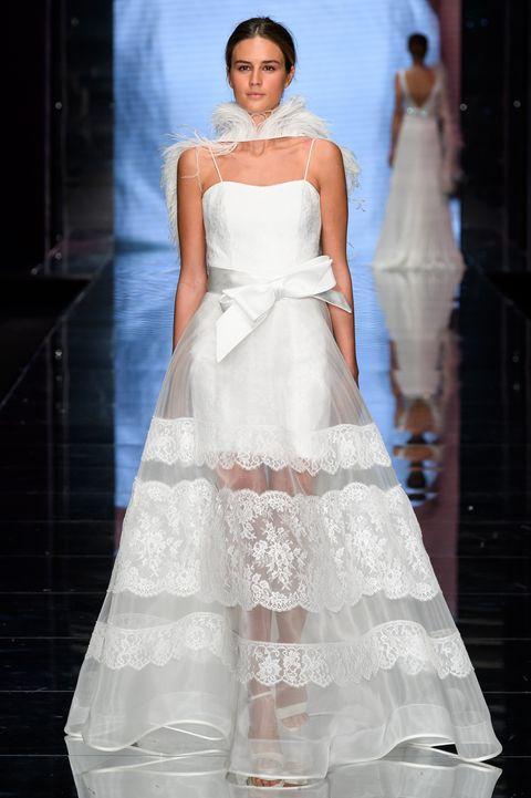 Wedding dress, Fashion model, Gown, Dress, Clothing, Fashion, Bridal clothing, Haute couture, Shoulder, Bridal party dress,