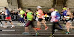 blurred runners in a race