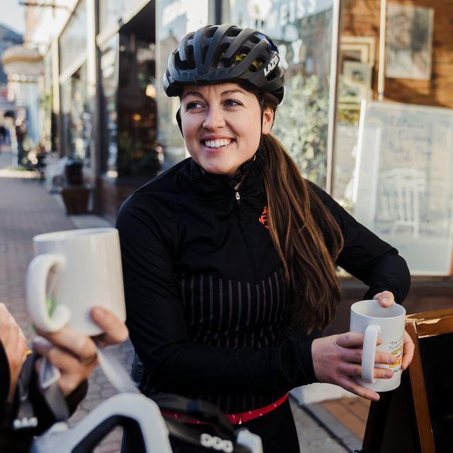 female cyclist drinking coffee