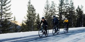 Three cyclists riding in the snow in Colorado