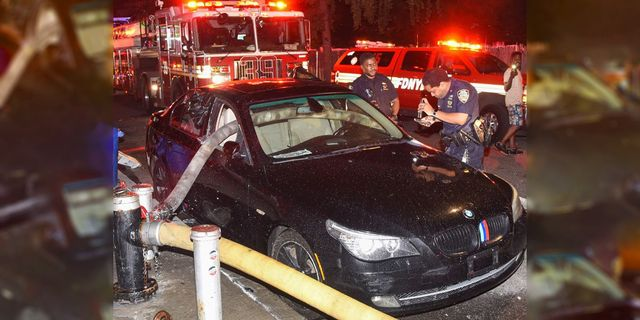 firefighters smash window of bmw parked in front of hydrant