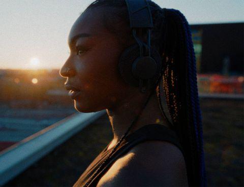 woman wearing adidas rpt 02 sol headphones