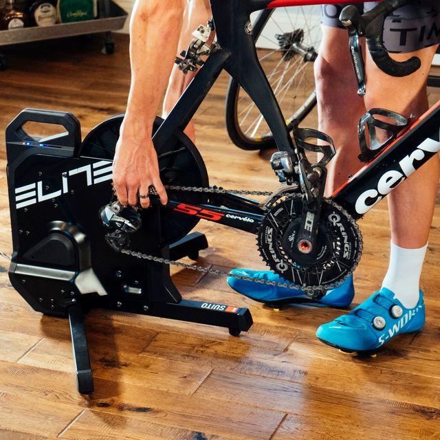 a cyclist setting up a direct drive bike trainer at home