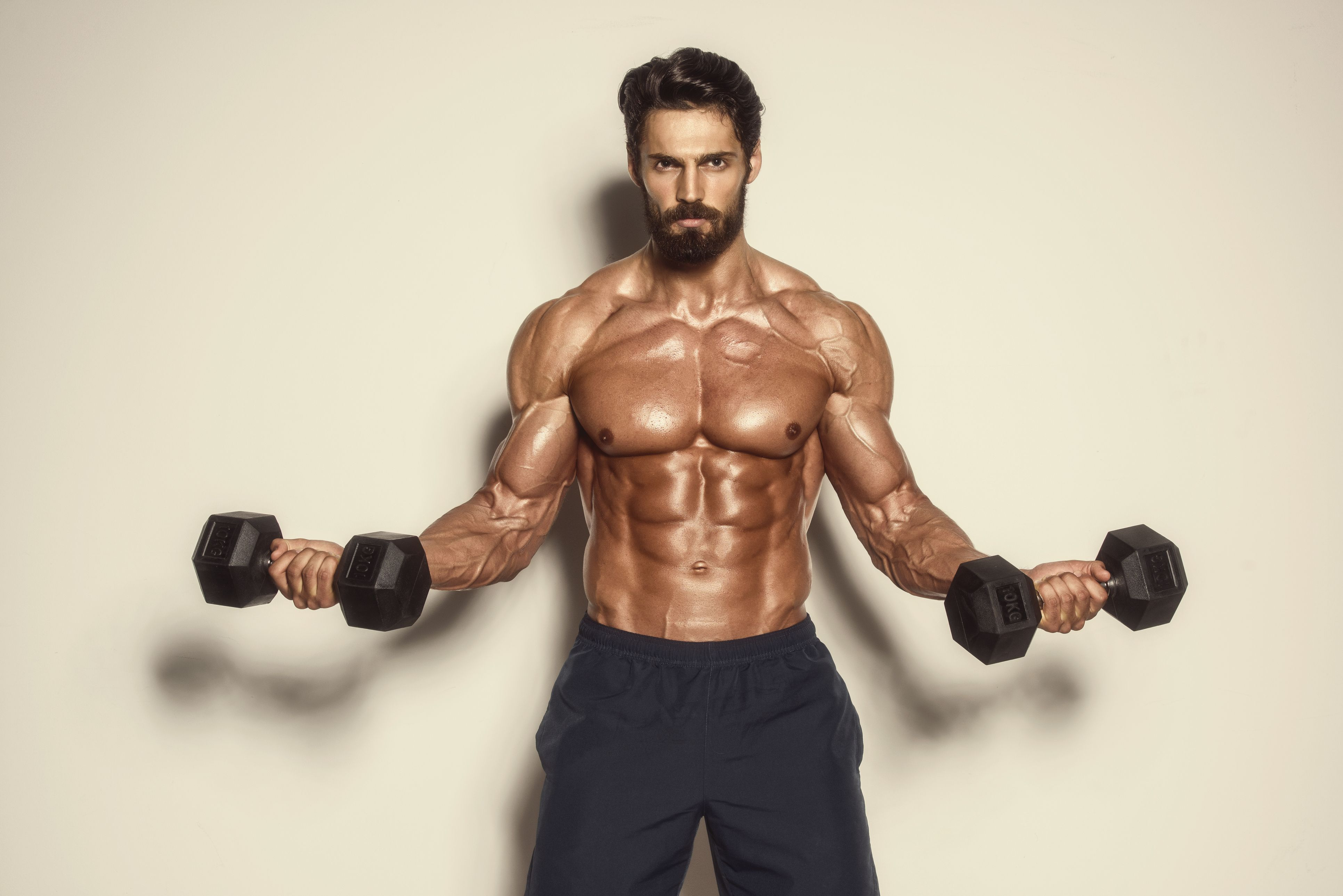 The home dumbbell workout for a six pack in three weeks