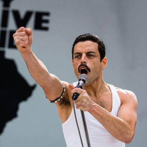 Yellow, Arm, Cheek, Microphone, Performance, Human, Event, Audio equipment, Hand, Technology,