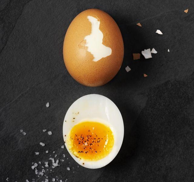 boiled eggs on black background