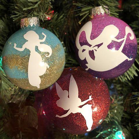 bolas de navidad con purpurina y silueta de princesas disney