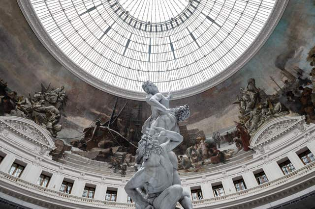 """a picture taken on may 12, 2021 shows a sculpture by swiss artist urs fischer, which is a wax replica of the marble sculpture by italian artist giambologna """"the rape of the sabine women"""", displayed at the bourse de commerce pinault collection, which houses french billionaire francois pinault's private art collection in paris   the bourse de commerce historic building in the centre of the french capital has been turned into a museum to show the 14 billion dollar 12 billion euro collection of modern masters of pinault, the luxury goods mogul who also owns the auction house christie's   restricted to editorial use   mandatory mention of the artist upon publication   to illustrate the event as specified in the caption photo by martin bureau  afp  restricted to editorial use   mandatory mention of the artist upon publication   to illustrate the event as specified in the caption  restricted to editorial use   mandatory mention of the artist upon publication   to illustrate the event as specified in the caption photo by martin bureauafp via getty images"""