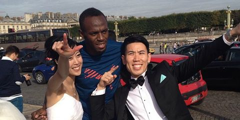 Usain Bolt with a Japanese wedding couple in Paris