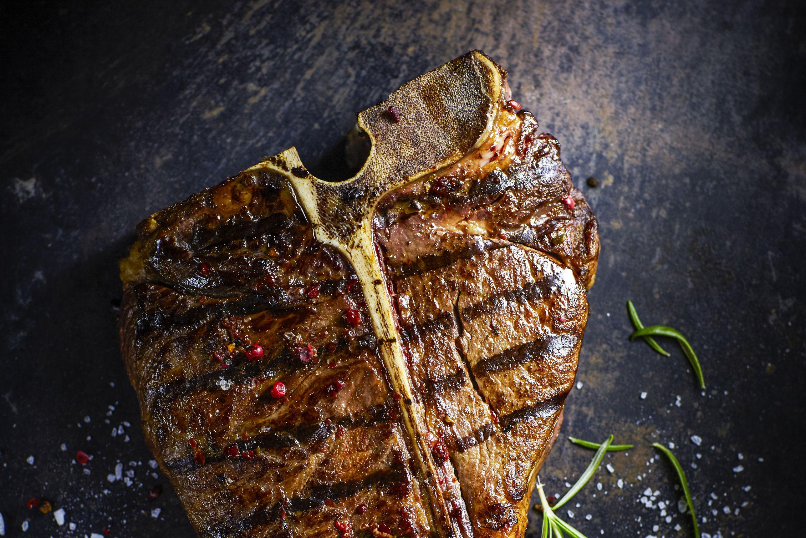 T-Bone-Steak, chili, onion, cherry tomato and rosemary