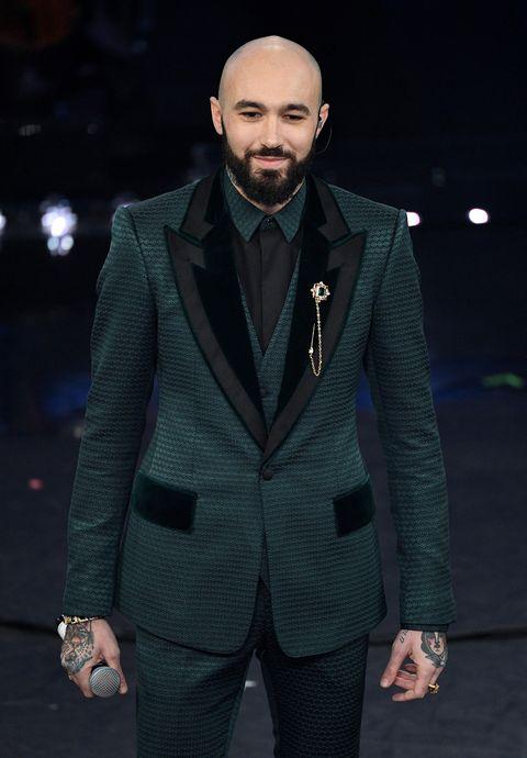 Suit, Fashion, Clothing, Facial hair, Formal wear, Outerwear, Blazer, Fashion show, Beard, Human,