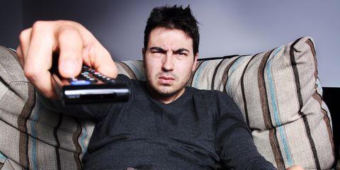 Bored man watching TV