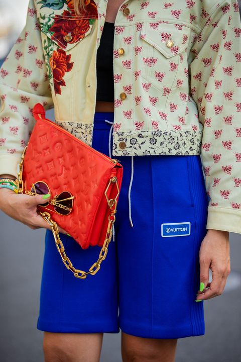 berlin, germany   june 15 sonia lyson is seen wearing total look louis vuitton, red bag, blue shorts, jacket with floral print, sandals with logo print and cropped black top on june 15, 2021 in berlin, germany photo by christian vieriggetty images