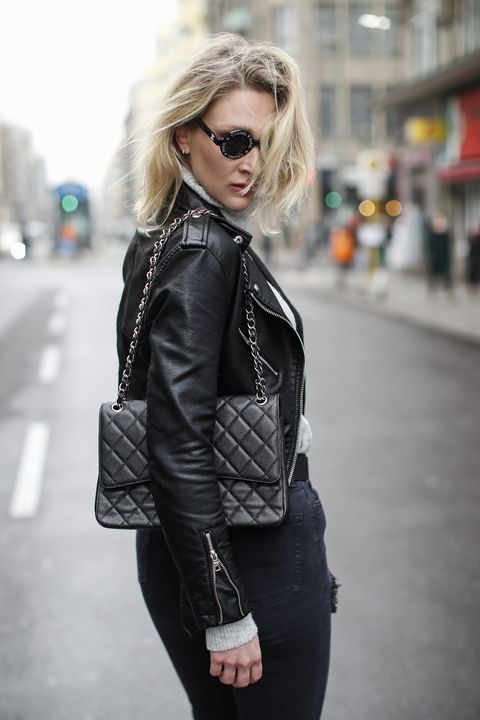 """berlin, germany   december 11 german model and actress victoria jancke wearing a grey knitted turtleneck pullover by vero moda, a black leather jacket by bershka, black and white round vintage sunglasses by chanel, sustainable gold earrings made by same jewelers as tiffany""""u2019s and louis vuitton out of 100 recycled gold by ana luisa, a black and silver flap bag by chanel and black ripped denim jeans by topshop during a street style shooting on december 11, 2020 in berlin, germany photo by streetstyleshootersgetty images"""