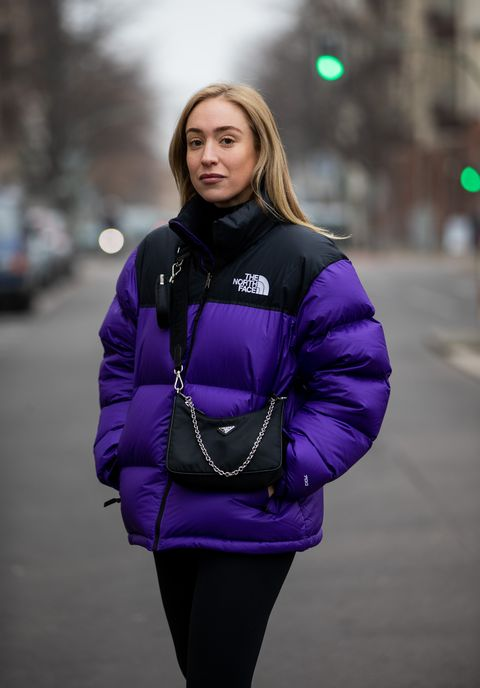 berlin, germany   december 10 sonia lyson is seen wearing prada bag, two tone puffer down feather jacket the north face in purple and black, lululemon leggins on december 10, 2020 in berlin, germany photo by christian vieriggetty images