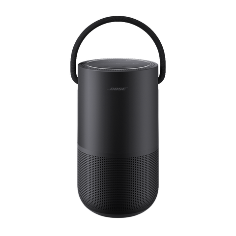 a black portable speaker with a handle on a gray background