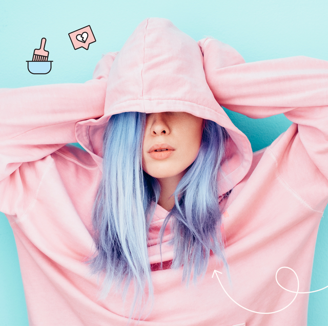 best hair color removers   image of a girl with purple hair covering her face with a pink sweatshirt