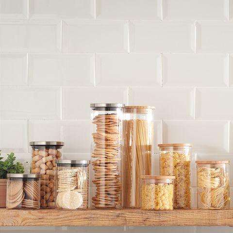 Shelf, Food storage containers, Mason jar, Furniture, Table, Shelving, Room, Glass, Glass bottle, Wood,