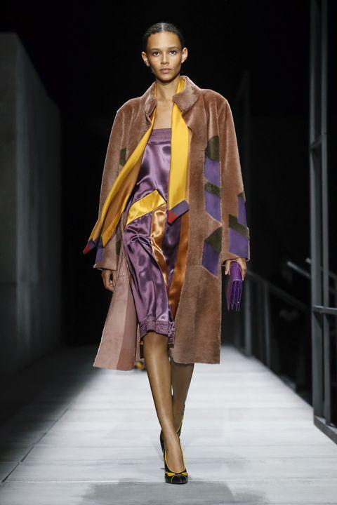 Fashion model, Fashion show, Fashion, Runway, Clothing, Fashion design, Yellow, Shoulder, Public event, Event,