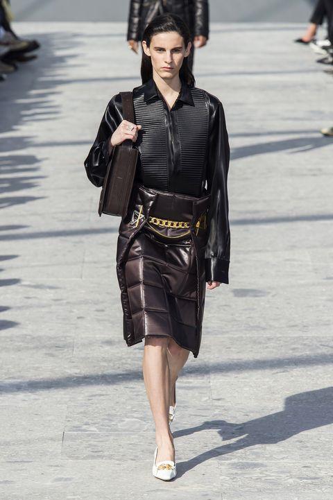 Fashion model, Fashion, Clothing, Fashion show, Street fashion, Runway, Leather, Leather jacket, Jacket, Human,