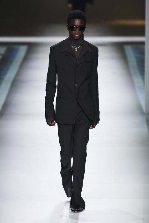 Fashion model, Fashion show, Fashion, Runway, Clothing, Suit, Formal wear, Human, Outerwear, Standing,