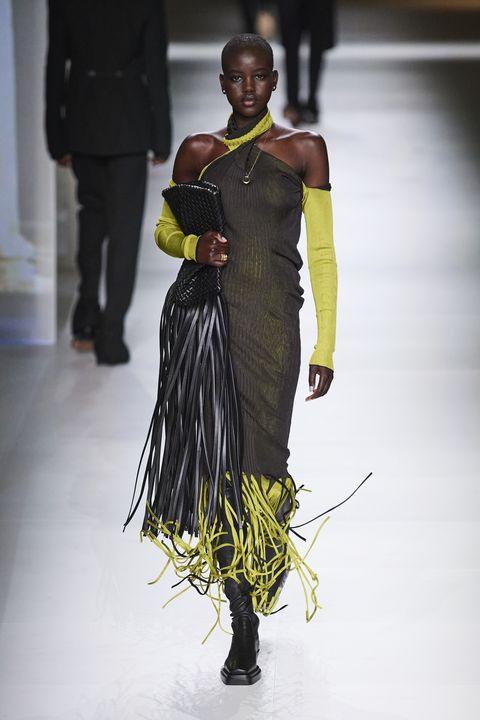 Fashion, Fashion model, Runway, Fashion show, Clothing, Fashion design, Yellow, Dress, Haute couture, Shoulder,