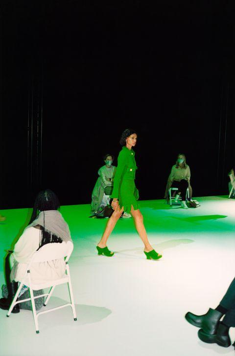 Green, Coat, Dress, Drama, Fashion, Knee, heater, Stage, Costume design, Scene,