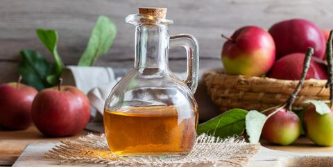 A Bottle Of Apple Cider Vinegar With Fresh Apples