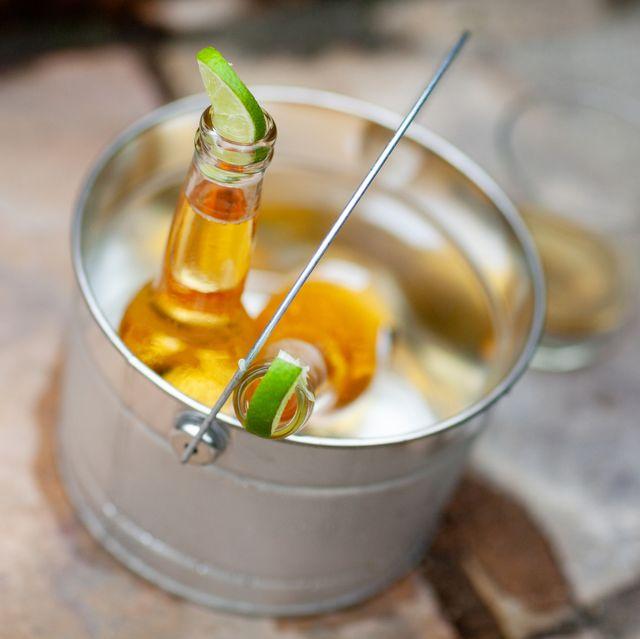 bottle of corona beer with lime in bucket