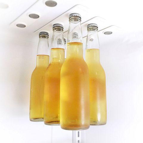 Yellow, Glass bottle, Drink, Bottle, Orange drink, Orange soft drink, Juice, Mimosa, Orange juice, Liqueur,