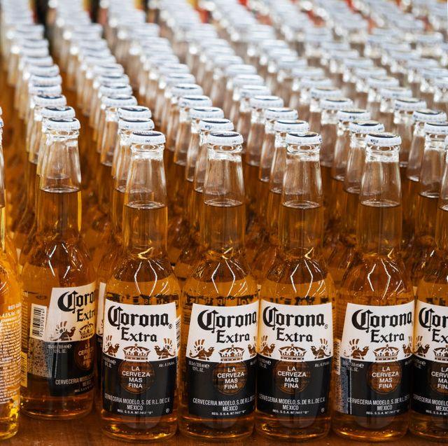 bottles of corona beer on a shelf in a store