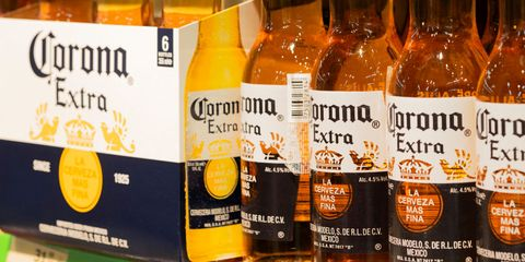 bottles of corona extra beer are seen on a shelf