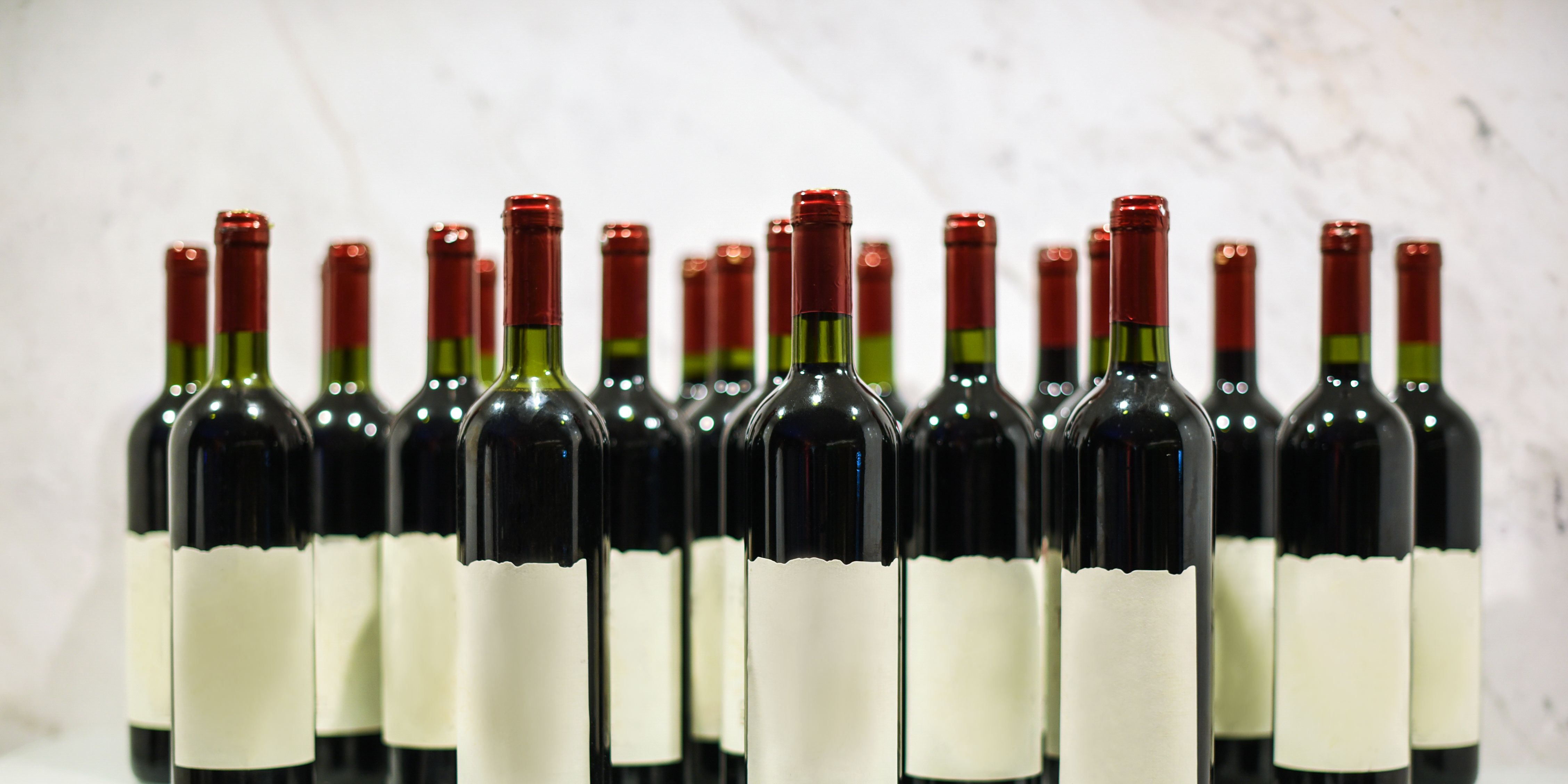 Bottles of red wine with blank front label